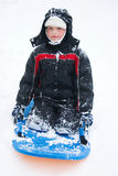 A boy on a sled. A boy sliding on a sled Stock Photography