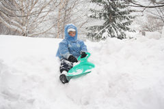 Boy on a sled Royalty Free Stock Photos