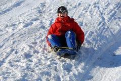 Boy on sled Royalty Free Stock Photos