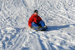 Boy on sled Royalty Free Stock Images