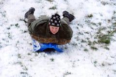 Boy on sled Stock Photos