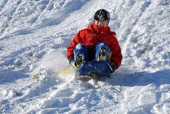 Boy on sled Royalty Free Stock Image