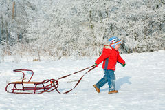 Boy with sled Stock Photo