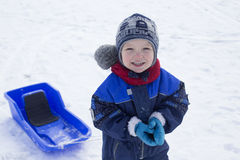 Boy and sled. Young boy and his plastic sled Stock Image