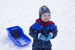 Boy and sled. Young boy and his plastic sled Royalty Free Stock Photos