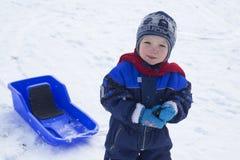 Boy and sled Stock Photos