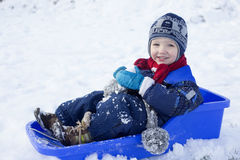 Boy and sled Royalty Free Stock Images