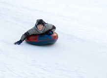 Boy Sledding Stock Photography