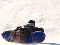 Boy sledding Stock Photography