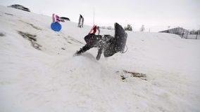 Boy sledding off jump slomo Stock Image