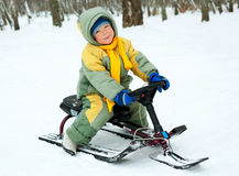 Boy with a sledge. Cute little boy with a sledge outdoor in winter park Stock Photo