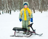 Boy with a sledge Royalty Free Stock Image