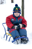 Boy on sledge Stock Photos