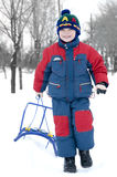 Boy with sledge Royalty Free Stock Photography