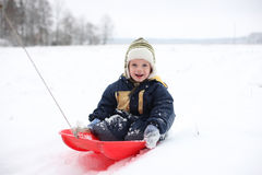 Boy in sledge Stock Photo