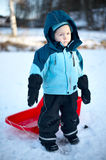 Boy with sledge Stock Photos