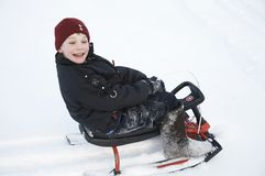 A boy on the sledge Stock Image