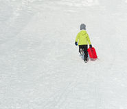 Boy on Sledge Stock Photos