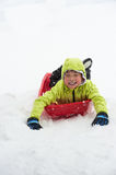 Boy on Sledge Stock Image
