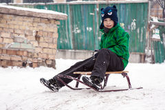 A boy on the sledge Royalty Free Stock Image