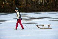 Boy with sledge Stock Photography