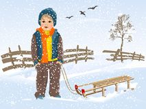 Boy with sledge Stock Photo