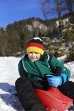 Boy and sledge Stock Photos