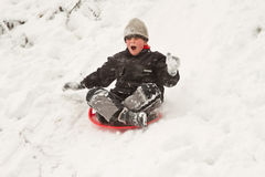 Boy on sledges Stock Images