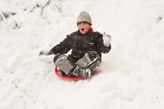 Boy on sledges Stock Images