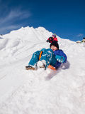 Boy sledging Royalty Free Stock Images