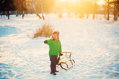 Boy Sledging In park Stock Photos