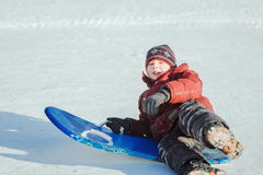 Boy sledging Stock Images
