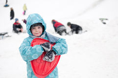 Boy with sleds on the hill Royalty Free Stock Photo