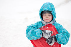Boy with sleds on the hill Stock Images