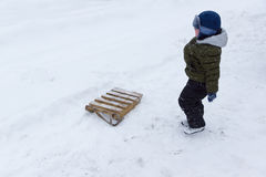 Boy with sleds are made of planks Stock Images