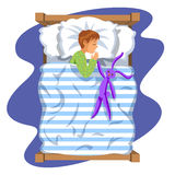 Boy sleep bedtime in his bedroom bed with toy bunny. Stock Image