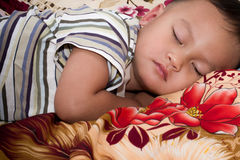 Boy sleep. Boy hood sleep on bed stock photography