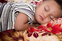Boy sleep. Boy hood sleep on bed Stock Photography