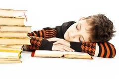 Boy sleep on the table. Isolated on white background Royalty Free Stock Image