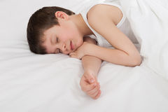 Boy sleep in white bed Stock Photo
