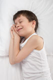 Boy sleep in white bed Stock Images