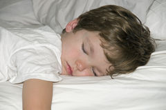 Boy sleeping. A small boy sleeping in a bed Stock Photo