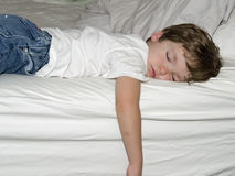 Boy sleeping. A small boy sleeping in a bed Royalty Free Stock Photo