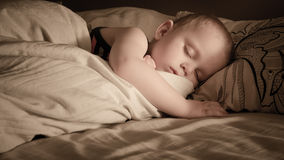 A boy Sleeping. A baby boy sleeping peacefully in his bed stock images