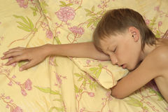 Boy sleeping in bed Royalty Free Stock Images