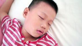 Boy sleeping on bed stock video footage