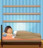 Boy sleeping in bedroom Stock Photography
