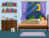 Boy sleeping in bedroom at night Stock Photo