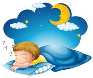 Boy sleeping on blue blanket Stock Photo
