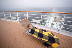 Boy sleeping  on board ship Royalty Free Stock Photography